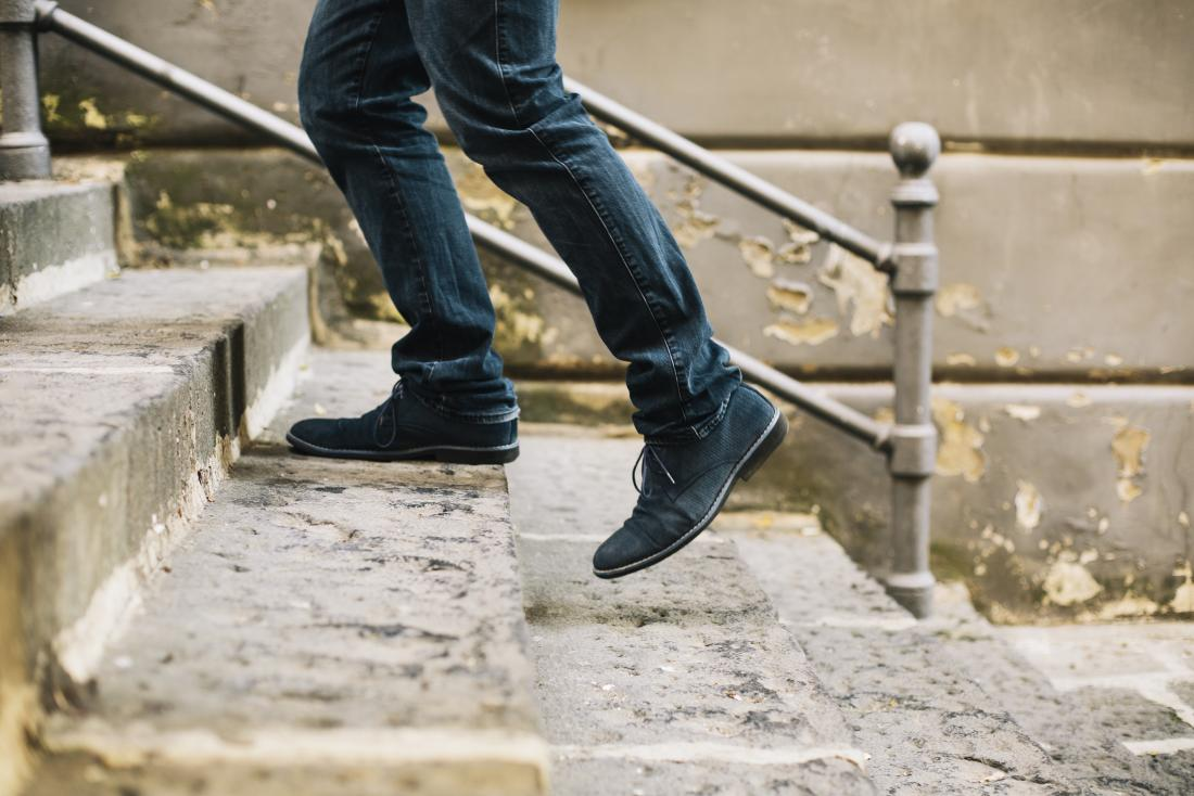 person-walking-up-stairs-outdoors-close-up-of-feet-and-legs-going-up-steps